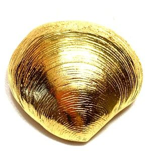 Vintage Small gold toned Monet shell brooch.